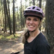 Veterinarian wearing a purple helmet win the forest